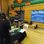 "Salinas Youth Radio Trainees at Community Event ""Juntos Podemos"" Speaking with Others about the Program"