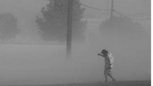 Dust storms, like this one in Fresno, can help distribute the fungal spores that cause valley fever. (Photo: Craig Kohlruss/The Fresno Bee)