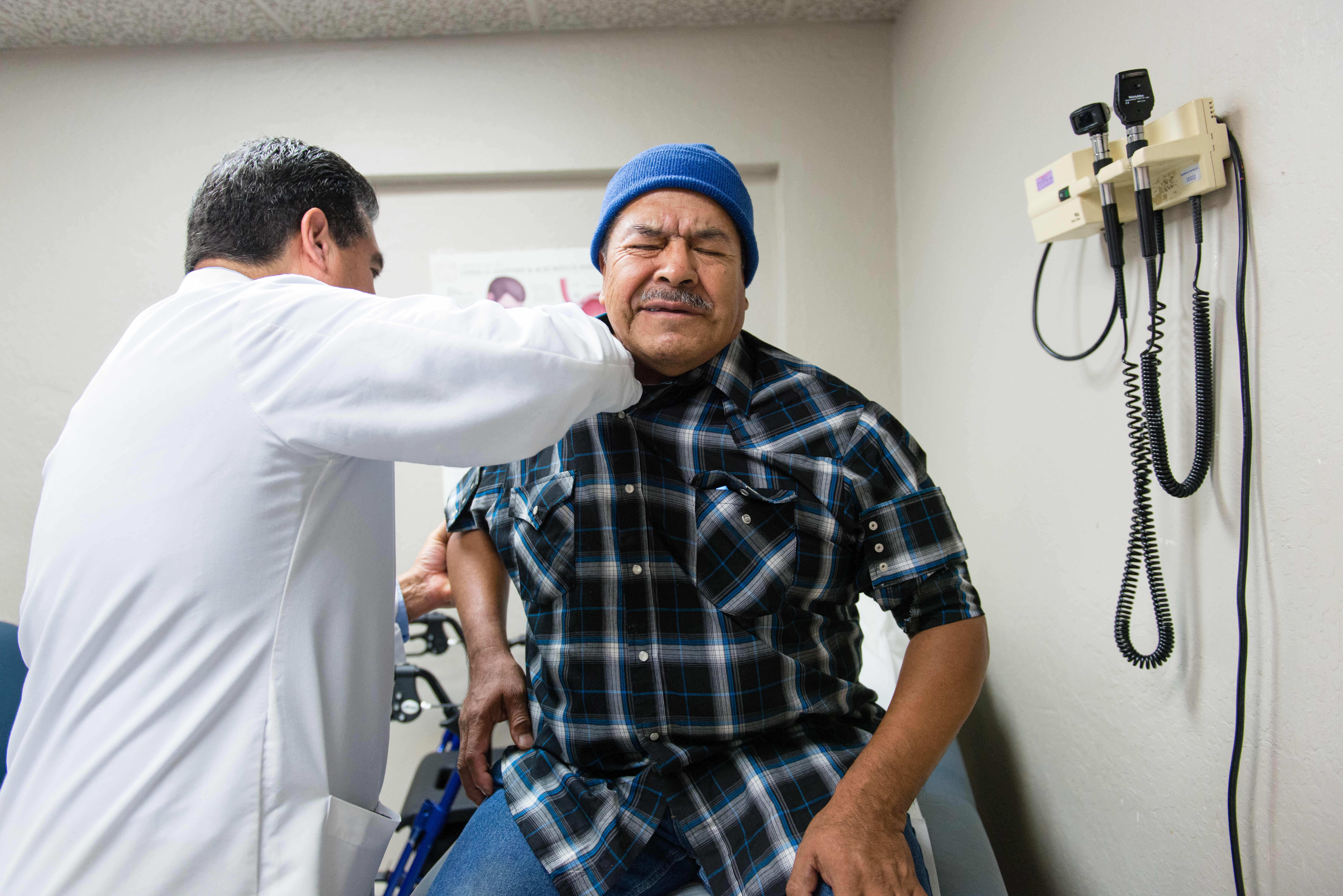 Luis Bautista, an internist at Bautista Medical Center in Fresno, Calif., examines farm worker Jose Gonzalez on February 8, 2017. Gonzalez says he is not ready to retire and needs his insurance to stay healthy. (Heidi de Marco/KHN)