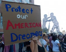 "Rallies and marches took place around the country on Tuesday following the Trump administration's decision to end the Deferred Action for Childhood Arrivals (DACA) program, which protects certain young immigrants from deportation. At one event in downtown Los Angeles, people held signs that read, ""We are here to stay,"" and chanted, ""If they won't let us dream, we won't let them sleep."" (Anna Gorman/KHN)"