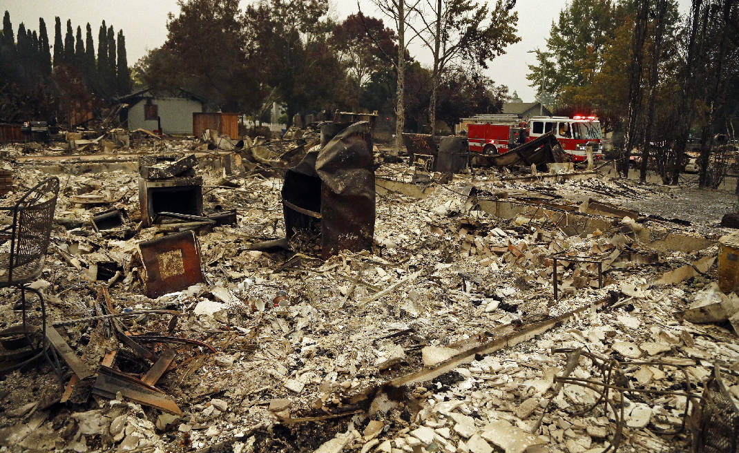 The Latest: California fires take 13 lives, more buildings | Times ... Chattanooga Times Free Press