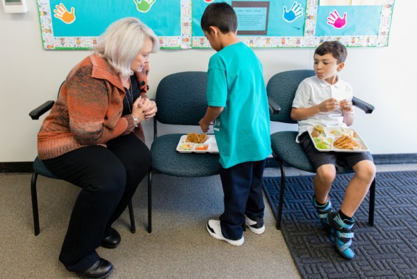 Nurse Catherin Crofton checks on two students at Cambridge Elementary in eastern Contra Costa County, Calif., on Oct. 16, 2016. Her position was paid for through a partnership with the Mount Diablo Unified School District and John Muir Health, a local health system. (Heidi de Marco/KHN).