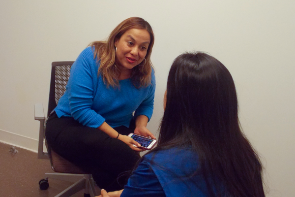 """The East Los Angeles Women's Center is opening a domestic violence shelter on the Los Angeles County-USC Medical Center campus. The proximity makes it easier for doctors to ask patients about violence, said Rebeca Melendez, director of wellness at the center's hospital office. """"They don't need to know all the answers,"""" she says. """"They just need to call us."""" (Anna Gorman/KHN)"""
