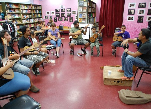 Students learn the jarana in a Son Jarocho class at Tia Chucha's Centro Cultural & Bookstore in Sylmar, Los Angeles. Betto Arcos