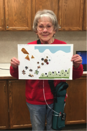 "Joan Cousins, who was diagnosed with COPD about two decades ago, holds a ""story collage"" made from puzzle pieces, fabric and buttons. The Union City, Calif., woman smoked for 46 years before quitting. (Courtesy of Joan Cousins)"
