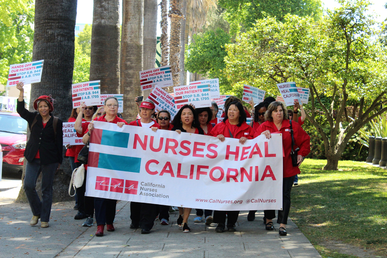 Bonnie Castillo leads nurses to the south steps of the state Capitol on May 1 to meet with legislators, just days ahead of National Nurses Week. (Ana B. Ibarra/California Healthline)