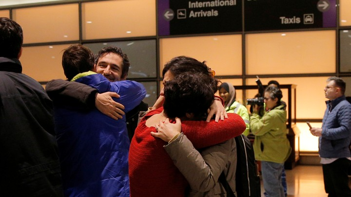 The Atlantic Mazdak Tootkaboni is reunited with friends and family after he was questioned as a result of Trump's immigration order, at Logan Airport in Boston.