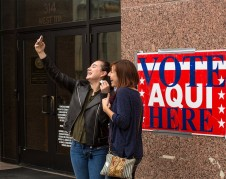 Voters take a selfie outside an early voting station in Austin on Feb. 23, 2018. Waylon Cunningham for The Texas Tribune
