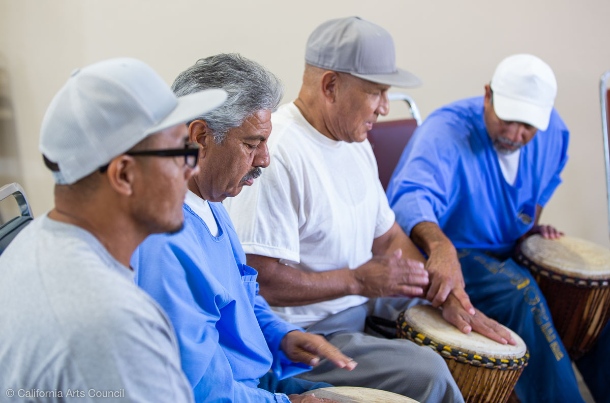 Avenal State Prison interns at drumming class.  Photo by Peter Merts, courtesy of the California Arts Council.