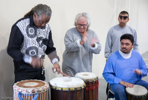 Abdullatif Bell Touncara teaches African drumming at Avenal Sate Prison.  Photo by Peter Merts, courtesy of the California Arts Council.