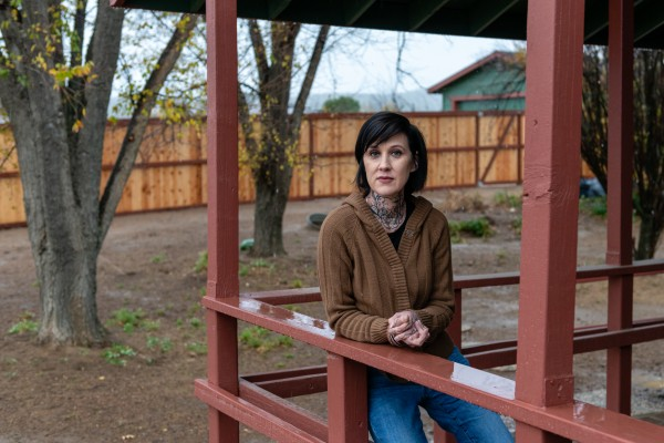 """Tracy Lystra at her home in Aguanga, Calif. In 2013, Lystra sued her Fallbrook, Calif., OB-GYN, Anthony S. Bianchi, alleging that he had sexually harassed her — which Bianchi denied. Lystra said the lawsuit was settled for $150,000 but that her attorney's subsequent complaint about the doctor to the Medical Board of California was rejected based on a review of the evidence and """"mitigating circumstances."""" In the meantime, Bianchi received two probation terms for alleged sexual misconduct with three other women. (Heidi de Marco/California Healthline)."""
