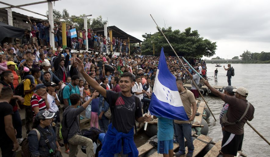 Caravan migrants break Guatemala border fence, rush Mexico - Washington Times