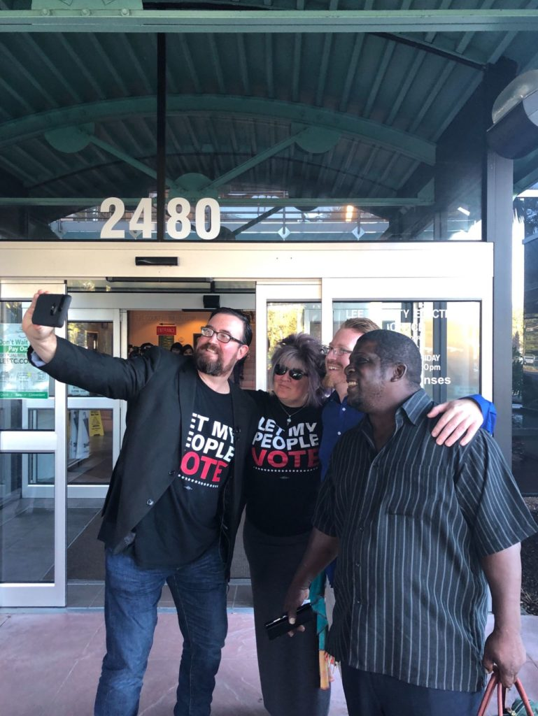 Amendment 4 Implemented In Florida, Re-Enfranchising 1.4 Million ... Tech iHunt NEIL AND PAM VOLZ, LANCE WISSINGER, AND PERMAN THOMAS TAKE A SELFIE OUTSIDE THE COUNTY BUILDING. CREDIT: ADDY BAIRD