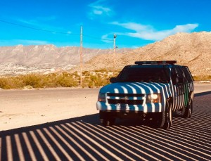 A Border Patrol truck in the shadow of the border wall in Sunland Park, NM, near where the UCP had its camp.