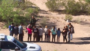 Migrants who have just crossed the border from Mexico into New Mexico near the UCP camp begin the process of requesting asylum on April 19, 2019.