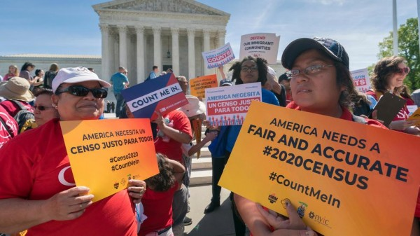 In this April 23, 2019 file photo, immigration activists rally outside the Supreme Court as the justices hear arguments over the Trump administration's plan to ask about citizenship on the 2020 census, in Washington. A New York judge says the Justice Department can't change lawyers so late in the dispute over whether to add a citizenship question to the 2020 census.