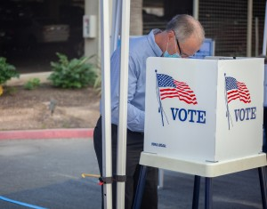 Madera County Supervisor, Robert L Poythress, votes at the mobile voting unit on the day of its launch. Photo by Maria Esquinca.